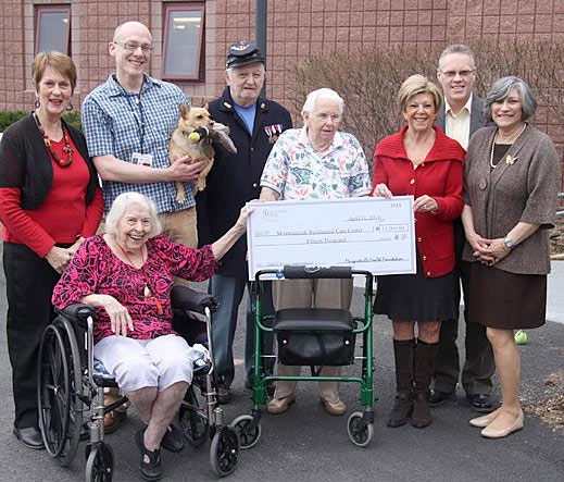 The Margaretville Health Foundation presents a check for $15,000 to benefit residents at Mountainside Residential Care Center.